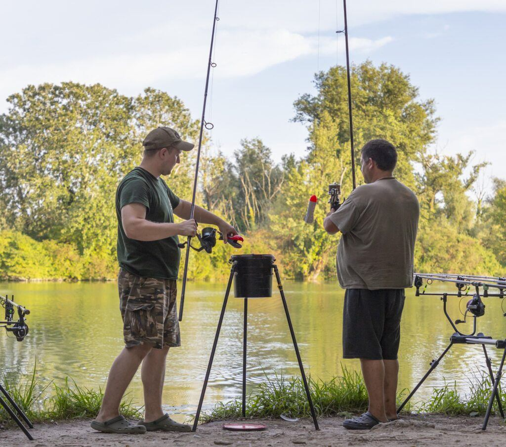 what is a spod rod - two men holding spod rods
