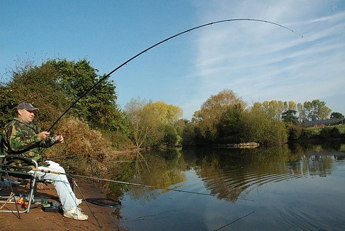 Man fishing with a feeder rod