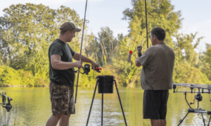 What is a spod - two men holding spod rods