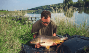 What is Carp fishing - carp on unhooking mat