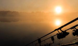 Autumn Carp Fishing Tips - Sun rising over carp lake