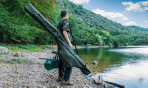 Margin fishing for carp - Man holding carp gear looking for fish