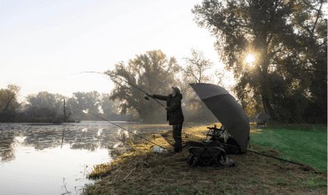 Best Season for Carp Fishing - Man casting carp rod