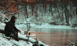 How to catch carp - carp fisherman in snow