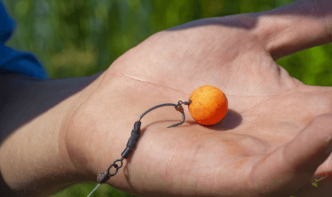 how to catch carp in spring - man holding chod