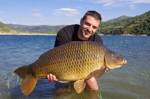 what-is-specimen-carp-fishing-man-holding-specimen-carp