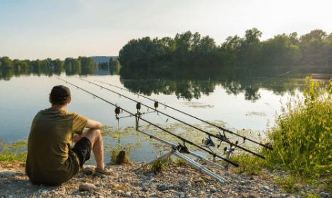 Carp Fishing Tips - Man Carp Fishing on sunny day