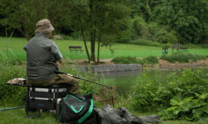 What is coarse fishing - angler on seatbox fishing for coarse fish (1)