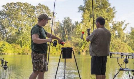 how-to-get-carp-feeding-two-men-holding-spod-rods