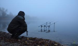 When do carp stop feeding in winter - Carp fisherman by foggy bank